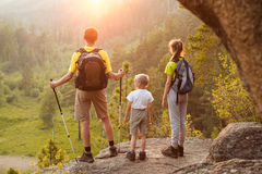 Father and children go hiking royalty free stock photo