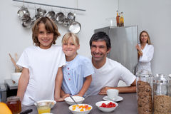 Father and children having breakfast Stock Photo