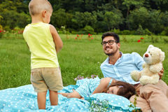 Father With Children Having Fun In Park. Happy Family In Nature. Father With Children Having Fun In Park. Happy Smiling Parent Playing With His Kids In Nature Royalty Free Stock Images