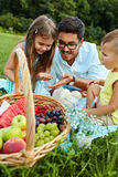 Father With Children Having Fun In Park. Happy Family In Nature Royalty Free Stock Images