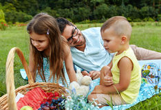 Father With Children Having Fun In Park. Happy Family In Nature. Father With Children Having Fun In Park. Happy Smiling Parent Playing With His Kids In Nature Stock Image