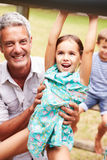 Father with children having fun at a playground Stock Image