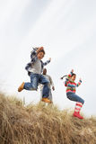 Father And Children Having Fun In Sand Dunes royalty free stock photo