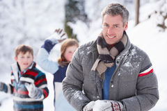 Father And Children Having Snowball Fight. In Winter Landscape Stock Photos