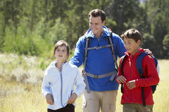 Father With Children On Hike In Beautiful Countryside Stock Photo
