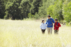 Father With Children On Hike In Beautiful Countryside Stock Photography