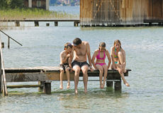 Father and children on holiday. Outdoor image of family at lake royalty free stock photography