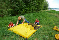 Father with children installing their tent Stock Photo