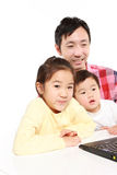 Father and children on laptop computer Stock Images
