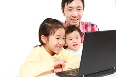 Father and children on laptop computer Royalty Free Stock Photography