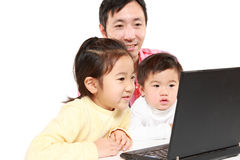 Father and children on laptop computer Stock Photo