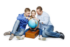 Father with children looking at earth globe Royalty Free Stock Image