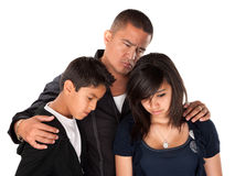 Father and Children Looking Sad. Hispanic father with kids looking down and sad on white background Stock Photography