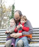 Father and children outdoors Royalty Free Stock Image