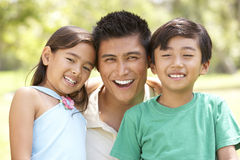 Father And Children In Park Stock Photo