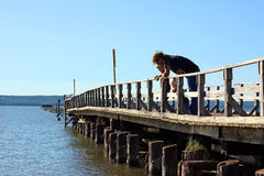 Father and Children on Pier Royalty Free Stock Photo