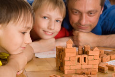 Father with children playing Stock Photos