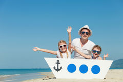 Father and children playing on the beach at the day time. Stock Photography