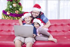 Father and children playing with a laptop Royalty Free Stock Photography