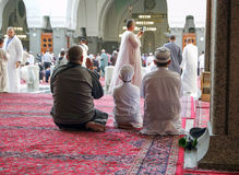 Father and children praying in mosque Royalty Free Stock Images