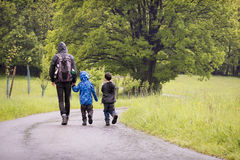 Father with children on rain spring walk Stock Image