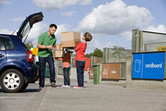 A father and children recycling cardboard boxes Royalty Free Stock Photo