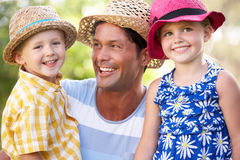Father And Children Relaxing In Summer Garden Stock Image