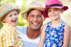 Father And Children Relaxing In Summer Garden Royalty Free Stock Photos