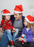 Father And Children In Santa Hats Stock Image