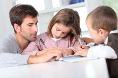 Father and children with school book Royalty Free Stock Photos