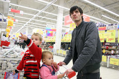 Father with children in shop Stock Images