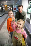 Father with children in shop Stock Image