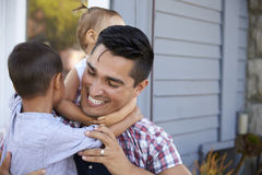 Father With Children Sitting On Steps Outside Home royalty free stock photos