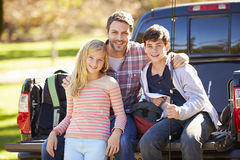 Father And Children Sitting In Truck On Camping Holiday Royalty Free Stock Photo