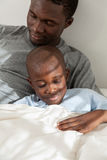 Father and children sleeping in the bed Royalty Free Stock Images