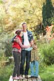 Father And Children Standing Outdoors Royalty Free Stock Photography