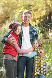 Father And Children Standing Outdoors Stock Photo