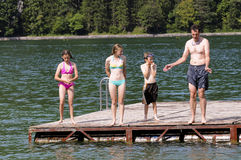 Father and children swimming. Portrait of family at the lake royalty free stock photography