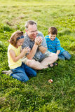Father and children trying to whistle Stock Photo