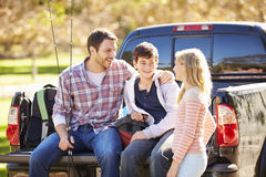 Father And Children Unpacking Truck On Camping Holiday Stock Images