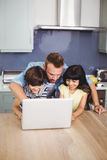 Father and children using laptop Stock Photography