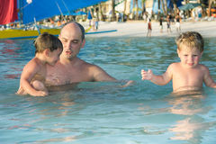 Father and children in water Stock Image