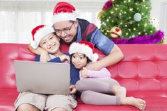 Father and children wearing Santa hat Royalty Free Stock Image