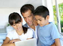 Father with children websurfing on tablet Royalty Free Stock Photo