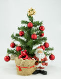 Father Christmas. With christmas tree and sack Royalty Free Stock Photography