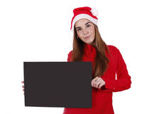 Father Christmas. Woman portraying father Christmas and holding an empty white card board Stock Photos
