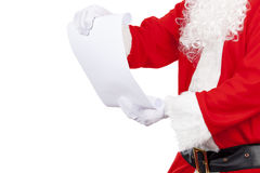 Father christmas checking his santa list royalty free stock photography