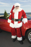 Father Christmas By Convertible With Christmas Tree Royalty Free Stock Photo