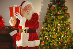 Father christmas delivering gift at christmas eve Stock Photo