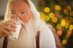 Father christmas drinking glass of milk Stock Photography